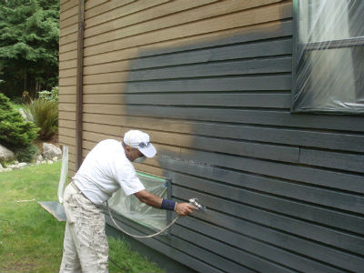 Spraying house cost to paint exterior of house image how much to paint a house - Cost to paint home exterior ...